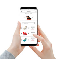 Shopping online - hands shopping shoes online on smartphone