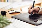 graphic designer and web development using pen tablet