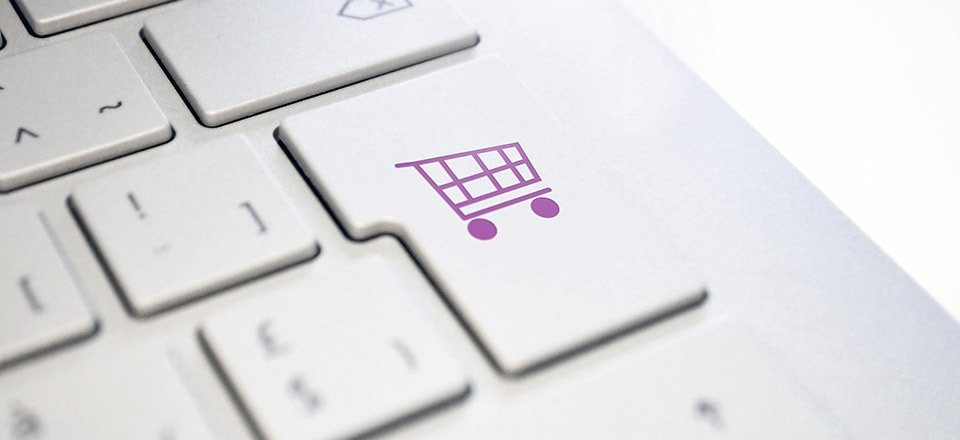 Keyboard with shopping cart icon