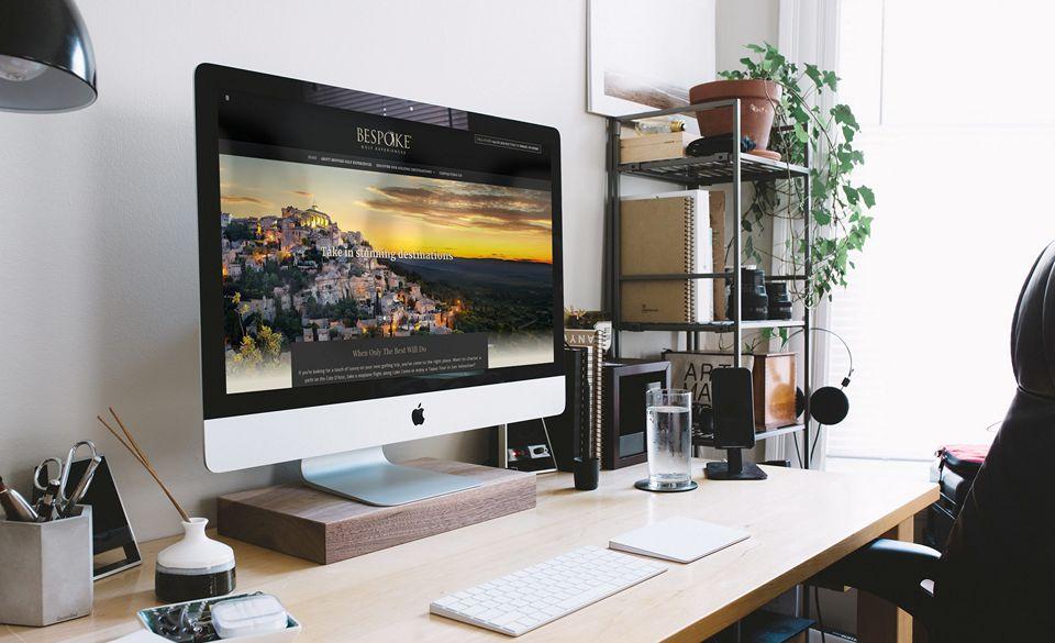 Desktop computer in modern office with example of brochure website (presentation)